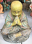 Praying Monk in cement. Size H20, L17, W14 cm. Price FOB 3,70 usd excl packing. Order code CP119.