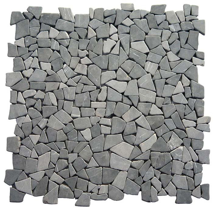 Puzzle Mosaic Interlock Grey Marble – The photo shows four tiles put together to show that the interlock system does not show any joints, compared with the square tile. The tiles on the photo are without  cement between the stones.